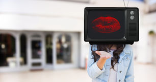 Girl sending a kiss with tv head. Stock Photo