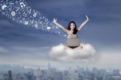 Girl sending message with laptop on cloud Royalty Free Stock Image