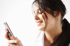 Girl sending an sms Royalty Free Stock Photo