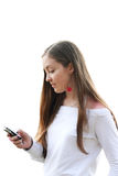 Girl sending sms- white Royalty Free Stock Photos