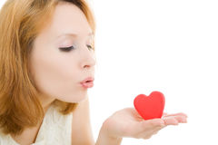 The girl sends an air kiss in the form of heart Stock Images