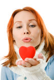 The girl sends an air kiss in the form of heart Royalty Free Stock Photo