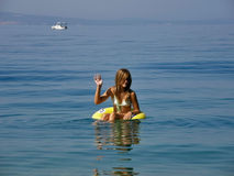 Girl sends greetings from the Adriatic sea. In the summer my family and I go early in the morning on the beach. The first morning activity is to jump into the royalty free stock photography
