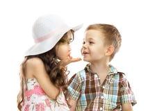 Girl sends kiss boy. Little girl kissing boy isolated over white background Stock Images