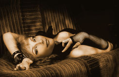 A Girl. Sepia. Beautiful young girl lying on a couch Stock Photos