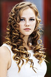 Girl serious curly Royalty Free Stock Photography