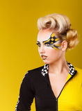 Girl serious racer. On yellow background. Royalty Free Stock Photo