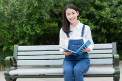 Girl in serious reading Stock Photos