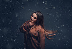 A girl servant wanders around at night stock photography