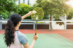 Girl serving on a badminton match outdoors Stock Photography