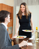 Girl serving dinner for beloved man Stock Photo