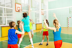 Girl serving jump float during volleyball match Royalty Free Stock Images