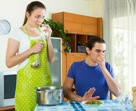 Girl serving lunch her man Royalty Free Stock Photography