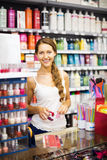 Girl serving purchaser with nail polish Stock Photos