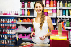 Girl serving purchaser with nail polish Royalty Free Stock Photo