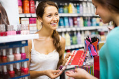 Girl serving purchaser with nail polish Stock Image