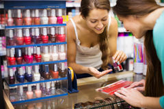 Girl serving purchaser with nail polish Royalty Free Stock Photos