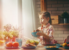 Girl sets the table for dinner Royalty Free Stock Photo