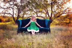 Girl on a settee in the countryside Royalty Free Stock Photos