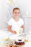 Girl setting table Stock Images