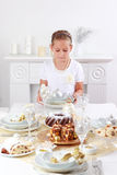 Girl setting table. Cute girl setting table for Christmas Royalty Free Stock Photos