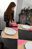Girl setting  the table Stock Photography