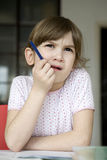 girl seven years old doing homework. Stock Photo