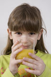 Girl seven years old drink orange juice Stock Photo