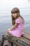Girl seven years old sitting on old bridge Royalty Free Stock Images
