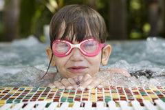 Girl seven years old with swimming glasses in swim Stock Images