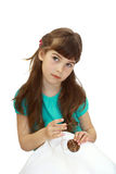 Girl sewing button Stock Images