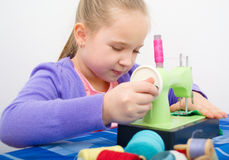 Girl sewing Stock Photos