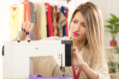 Girl With A Sewing Machine Stock Photography
