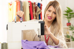 Girl With A Sewing Machine Royalty Free Stock Photography