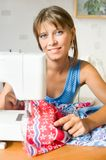 The girl sews Stock Image