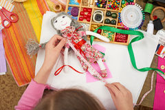 Girl sews doll clothes, measurement length, sewing accessories top view, seamstress workplace, many object for needlework, handmad Stock Images