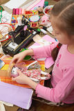 Girl sews doll clothes, top view, sewing accessories top view, seamstress workplace, many object for needlework, handmade and hand Stock Photo