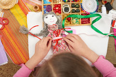 Girl sews doll clothes, top view, sewing accessories top view, seamstress workplace, many object for needlework, handmade and hand Royalty Free Stock Images