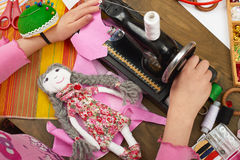 Girl sews doll clothes, top view, sewing accessories top view, seamstress workplace, many object for needlework, handmade and hand Stock Photography