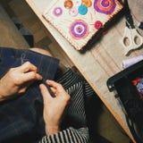 Girl sews fashionable dress.  Stock Image