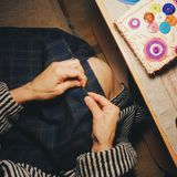 Girl sews fashionable dress.  Royalty Free Stock Image