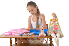 The girl sews toys from fabric Stock Photo