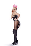 Girl in sexy black body and pantyhose with pink bow Royalty Free Stock Photos
