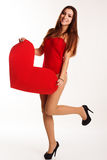 Girl in sexy bodi holding big paper heart. Pretty slim teenager girl is wearing red sexy bodi holding red big paper hearts over white background, valentines day Stock Images