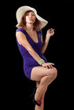 Girl in sexy dress with a hat. Isolated on black background Stock Images
