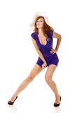 Girl in sexy dress with a hat Stock Photography