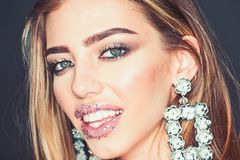 Girl with lips makeup. woman with glitter gem on lips. Fashion model with trendy look. Glamour jewelry of stock image