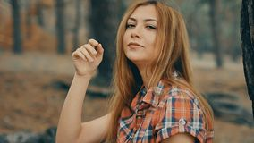 Girl sexy in plaid shirt in forest pine slow motion stock video