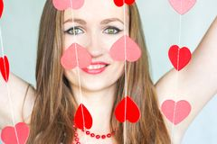 Girl sexy retro with hearts. on. A white background a charming woman Stock Photo