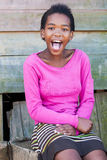 Girl in the shacks Stock Photography